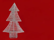 Christmas tree decoration. Close up of handmade silver Christmas tree decoration on red background with copy space Royalty Free Stock Image