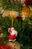 Christmas-tree decoration. Little toy Santa on Christmas-tree Stock Photo