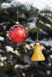 Christmas tree decoration 8. Christmas tree decoration handing on fir tree covered with snow Stock Photos