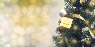 Christmas tree decoration on abstract light golden bokeh background royalty free stock photos