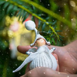 Christmas Tree Decoration Angel in Hands of Little Girl Stock Photos