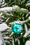 Christmas tree decoration ball. Decoration ball hanging on a snow-covered Christmas tree Stock Photography