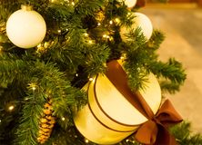 Christmas tree decoration box round cream with brown ribbon and white balls. Close-up stock photos