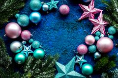 Christmas tree decoration frame with balls and stars toys on blue background top view space for text. Christmas tree decoration frame with balls and stars new Stock Images