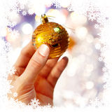 Christmas-tree decoration on hand Stock Photo