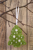 Christmas tree decoration hanging on a twig Royalty Free Stock Image