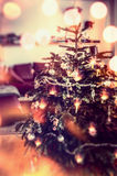 Christmas tree with decoration and holiday lighting with bokeh, festive home scene Royalty Free Stock Photography