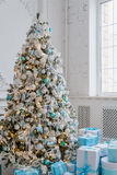 Christmas tree decoration at home interior with blue gift boxes Royalty Free Stock Image