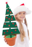 Christmas tree decoration in litte girl hand Royalty Free Stock Photos