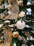 Christmas tree decoration ornaments white glitter ball and gold butterfly Stock Images