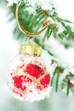 Christmas tree decoration outside in winter. Red Christmas tree decoration outside in winter snowfall Stock Image