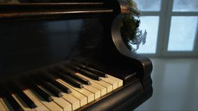 Christmas tree and decoration with piano. stock video