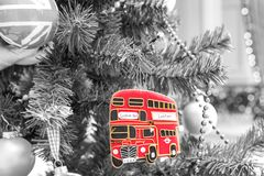 Christmas tree decoration with red british bus. Black and white style royalty free stock images