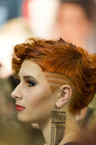 Portrait of beautiful woman at the hair fashion show. Kiev, Ukraine - September 18, 2014: A model gets ready backstage for the hair fashion show at Intercharm royalty free stock photography