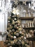 Christmas tree decoration in a small store. Christmas decorations on the shelves. royalty free stock photography