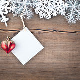 Christmas tree decoration and snowflakes on a wooden background Stock Photography