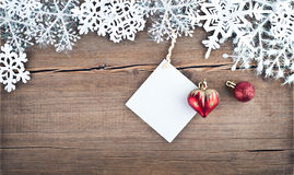 Christmas tree decoration and snowflakes on wooden background Stock Photo