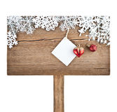 Christmas tree decoration and snowflakes on wooden background Stock Image