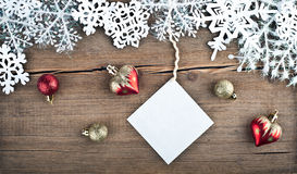 Christmas tree decoration and snowflakes on wooden background Royalty Free Stock Images