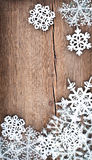 Christmas tree decoration and snowflakes on wooden background Royalty Free Stock Image
