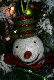 Christmas tree decoration. Snowman colorful glitter covered ornament hanging on Christmas tree Stock Photos
