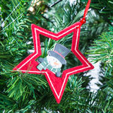 Christmas tree decoration star and snowman Royalty Free Stock Photography