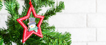 Christmas tree decoration star and snowman Stock Photo