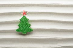 Christmas tree decoration on textured sand Stock Photos
