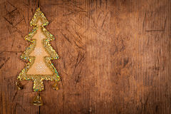 Christmas tree decoration with three bell on wood table Royalty Free Stock Images