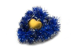 Christmas-tree decoration and tinsel in the form o. Christmas decoration in the form of hearts, Christmas toys Stock Photos