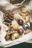 Christmas tree decoration toys and cones in box, vertical composition stock image