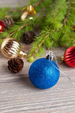 Christmas tree and decoration on a wooden background. Vertical Stock Photo