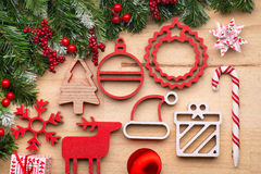 Christmas tree decoration with wooden ornaments on wooden background Stock Photography