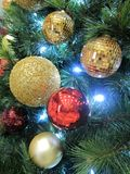 Christmas-Tree Decorations. Christmas tree decorations with lights and Christmas Ball Stock Photos