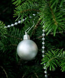 Christmas tree decorations. Detail of christmas-tree decorations with silver ball Royalty Free Stock Photos