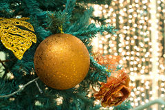 Christmas tree decorations. Fragment of christmas tree with gilt ball, flower and leaf stock image