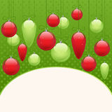 Christmas tree decorations. Christmas background with red and green Christmas tree decorations with place for text Royalty Free Stock Images