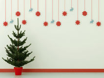 Christmas tree and decorations. Green tree against a blue wall with Christmas decorations Stock Photography