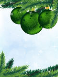 Christmas tree and decorations. Pine branches and  green Christmas balls on a blue sparkling background Royalty Free Stock Photos