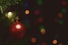 Christmas tree decorations. Against the backdrop of colorful blurred spots Royalty Free Stock Photo