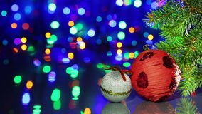 Christmas tree decorations balls on blinking background stock video