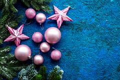 Christmas tree decorations with balls and stars toys on blue background top view space for text Royalty Free Stock Photography