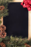 Christmas tree decorations and blackboard Stock Images