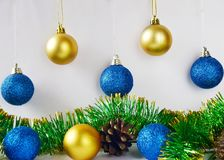Free Christmas Tree Decorations Blue And Yellow Balls On White Background Close Up. Royalty Free Stock Image - 163496046