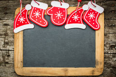 Christmas tree decorations border on vintage wooden blackboard Royalty Free Stock Photography