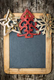 Christmas tree decorations border on vintage wooden blackboard Royalty Free Stock Photo