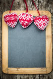 Christmas tree decorations border on vintage wooden blackboard Stock Photos