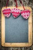 Christmas tree decorations border on vintage wooden blackboard Stock Photos