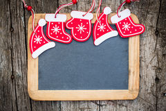 Christmas tree decorations border on vintage wooden blackboard Stock Images