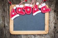 Christmas tree decorations border on vintage wooden blackboard stock images